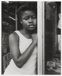 a girl in deli doorway, fulton street, brooklyn, ny by dawoud bey
