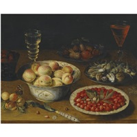 a still life with peaches, fraises de bois, mulberries and plums, together with a plate of hazelnuts and walnuts, a knife and two wine glasses on a wooden tabletop by osias beert the elder