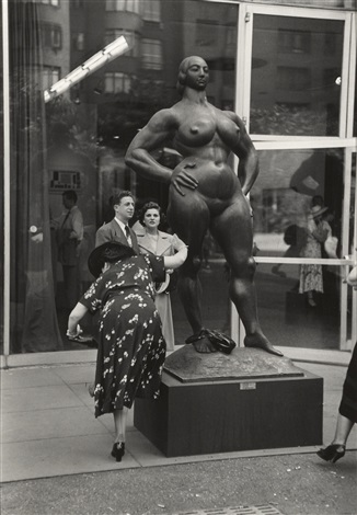 woman shaking pebble from her shoe moma garden gaston lachaise sculpture nyc by ruth orkin