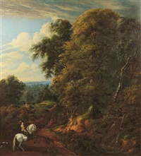 a wooded landscape with a horseman near a stream by cornelis huysmans