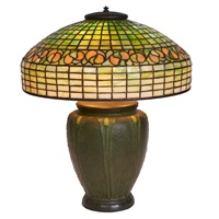 swirling lead table lamp by tiffany and grueby