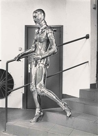 le corps robot descending stairs, monte carlo by helmut newton