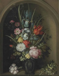 irises, lilies, wallflowers, forget-me-nots, roses, and other flowers in a glass vase with a lizard and sea holly in a stone niche by roelandt savery