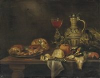 a silver plate with seafood by alexander adriaenssen