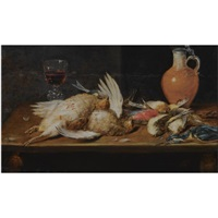 a still life with a robin, a kingfisher, partridges and songbirds, all on a wooden table, together with a glass and an earthenware jug by alexander adriaenssen