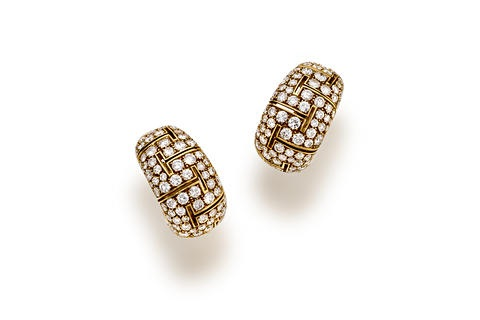 a pair of earrings by bulgari