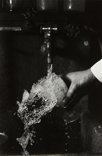 tap water splashing from a glass by harold eugene edgerton