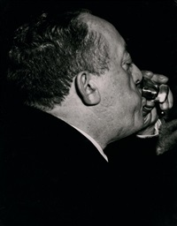 a man's face taking a drink by weegee