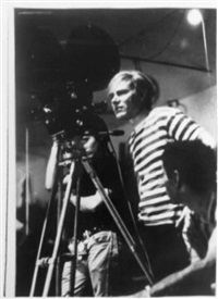 andy warhol with camera at the factory by billy name