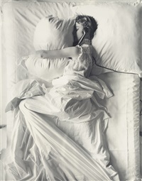 girl (in bed) on telephone by irving penn