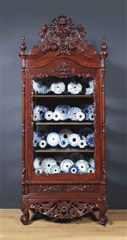 cabinet (installation of 35 delft saw blades) by wim delvoye