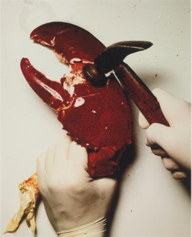 cracking a lobster claw, new york by irving penn