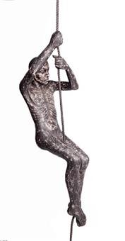 man climbing a rope by john r. davies