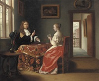 an elegant couple playing cards by samuel van hoogstraten