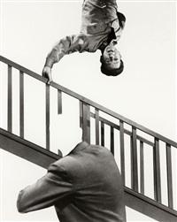 stairway, coat and person by john baldessari