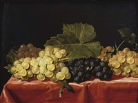 red and white grapes on a draped table by paul liegeois