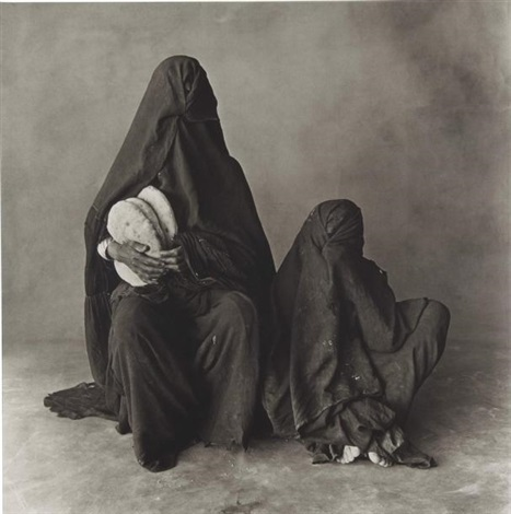 two women in black with bread marocco by irving penn