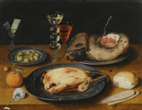 a still life of a roast chicken, a ham and olives on pewter plates with a bread roll, an orange, wineglasses and a rose on a wooden table by osias beert the elder