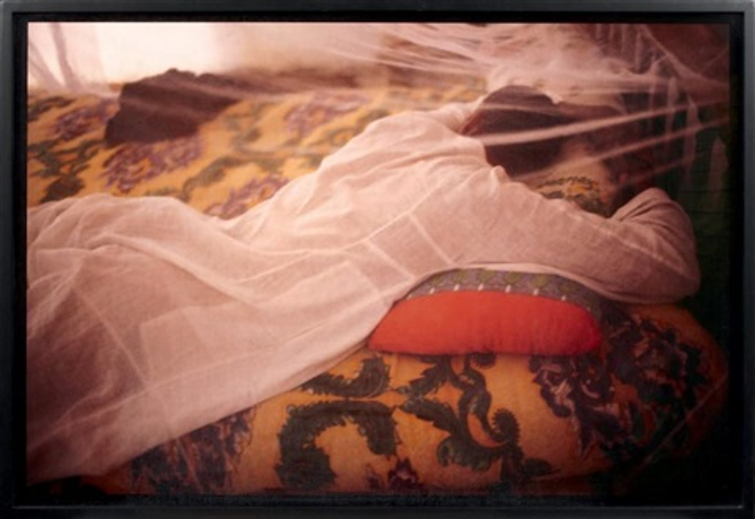 jabolowe sleeping under his mosquito net luxor egypt by nan goldin