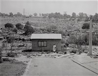 mrs miriam mazibuko watering her garden, extension 8, far east alexandra township, johannesburg. 12 september by david goldblatt