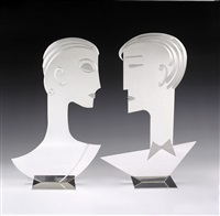 a pair of silvered-brass heads by franz hagenauer
