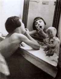 little girl putting on make-up by rogi andré