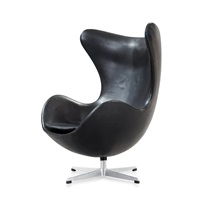 an arne jacobsen black leather 'egg chair' by arne jacobsen