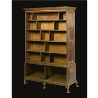 a double-sided bookcase and display cabinet by edwin henry lutyens