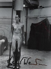 standing nude in garage, italdesign turrin by helmut newton