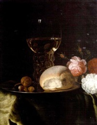 a roemer of white wine, walnuts and a bread roll on a silver plate, beside roses on a table draped with a green velvet cloth by simon luttichuys