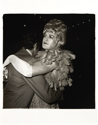 two men dancing at a drag ball, new york city by diane arbus