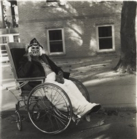 masked woman in a wheelchair, pa by neil selkirk and diane arbus