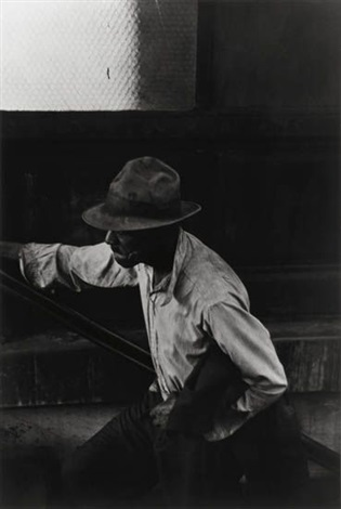 man coming up subway stairs by roy decarava