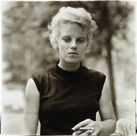 girl with a cigar in washington square park nyc by diane arbus