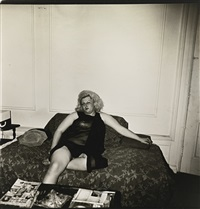 transvestite on a couch, nyc by diane arbus