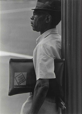 untitled man with portfolio by roy decarava