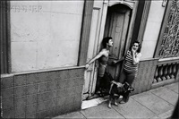 couple with dog in doorway by paul ickovic