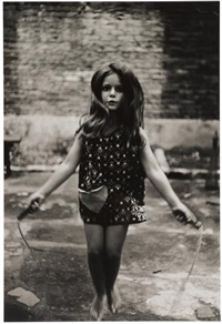 barefoot child jumping rope, nyc by diane arbus