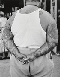 tattooed man - coney island by leon levinstein
