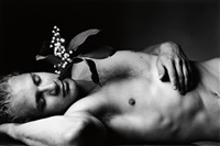 young men dream in the garden of the dead with flowers growing from their heads by duane michals