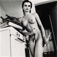 nue, cusine avec poulet roti, couteau et fourchette (from les filles de playboy) by helmut newton