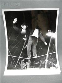 man walking a tightrope (multiple exposure) by weegee