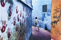 boy in mid-flight, jodhpur, india by steve mccurry