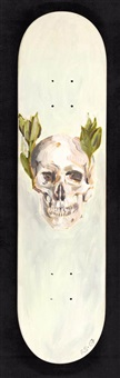 skull with bay leaves by ricky swallow