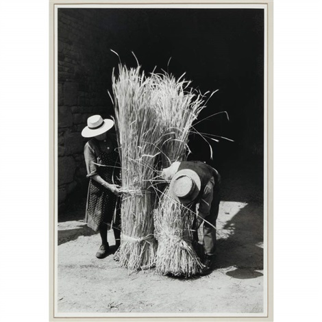 france man and woman with sheaves by edouard boubat