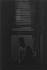 man in window, new york by roy decarava