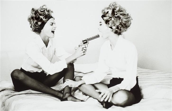 linda and christie with toy gun cannes by ellen von unwerth