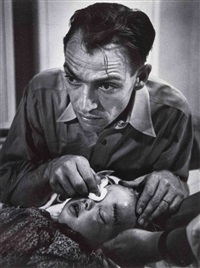 dr. ernest ceriani tending to lee marie wheatly (from country doctor essay) by w. eugene smith