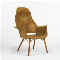 high back armchair from the museum of modern art organic design competition by eero saarinen and charles eames