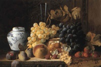 fruit still life with ginger jar and rug on carved table by charles e. baskett